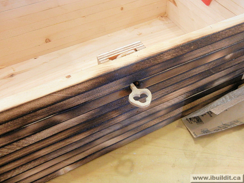 wooden key in wood lock in treasure box