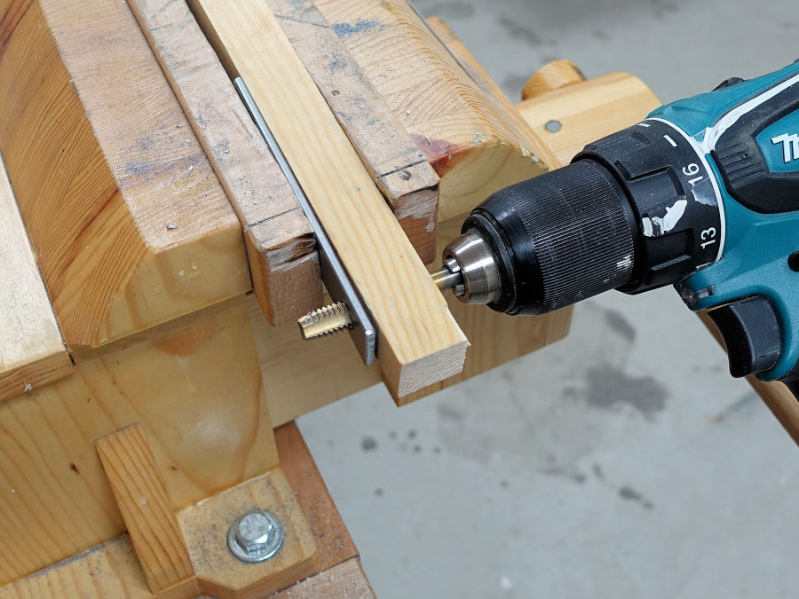 making a wood and steel bar clamp